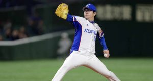 TOKYO, JAPAN - NOVEMBER 11: Pitcher Yang Hyeonjong #54 of South Korea throws in the top of 1st inning during the WBSC Premier 12 Super Round game between South Korea and USA at the Tokyo Dome on November 11, 2019 in Tokyo, Japan.