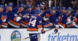 NEW YORK, NEW YORK - FEBRUARY 25: Jean-Gabriel Pageau #44 of the New York Islanders scores at 17:04 of the second period against the New York Rangers at NYCB Live's Nassau Coliseum on February 25, 2020 in Uniondale, New York.