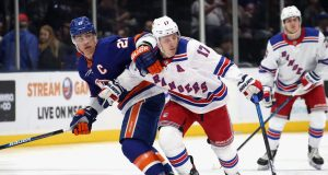 NEW YORK, NEW YORK - FEBRUARY 25: Anders Lee #27 of the New York Islanders holds back Jesper Fast #17 of the New York Rangers at NYCB Live's Nassau Coliseum on February 25, 2020 in Uniondale, New York. The Rangers defeated the Islanders 4-3 in overtime.