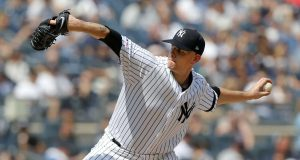 NEW YORK, NEW YORK - AUGUST 17: James Paxton #65 of the New York Yankees pitches during the third inning against the Cleveland Indians at Yankee Stadium on August 17, 2019 in New York City.
