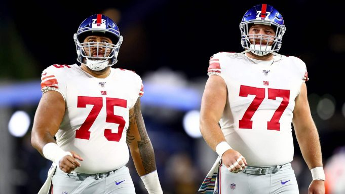 FOXBOROUGH, MASSACHUSETTS - OCTOBER 10: Jon Halapio #75 and Spencer Pulley #77 of the New York Giants look on prior to the game against the New England Patriots at Gillette Stadium on October 10, 2019 in Foxborough, Massachusetts.