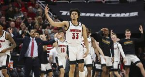 LOUISVILLE, KENTUCKY - FEBRUARY 08: Jordan Nwora #33 of the Louisville Cardinals celebrates after making a three-point shot against the Virginia Cavaliers during the first half of the game at KFC YUM! Center on February 08, 2020 in Louisville, Kentucky.