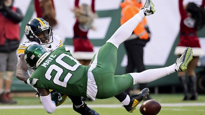 EAST RUTHERFORD, NEW JERSEY - DECEMBER 22: Marcus Maye #20 of the New York Jets breaks up a pass intended for James Washington #13 of the Pittsburgh Steelers during the second half at MetLife Stadium on December 22, 2019 in East Rutherford, New Jersey.