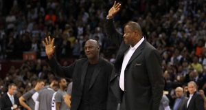 SHENZHEN, CHINA - OCTOBER 11: Michael Jordan, Owner of Charlotte Hornets and Patrick Ewing of Charlotte Hornets wave to fans during the match between Charlotte Hornets and Los Angeles Clippers as part of the 2015 NBA Global Games China at Universiade Centre on October 11, 2015 in Shenzhen, China.