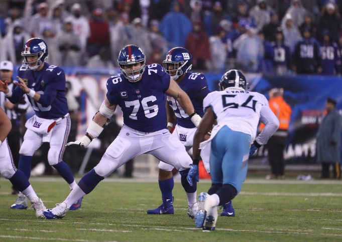 EAST RUTHERFORD, NEW JERSEY - DECEMBER 16: Nate Solder #76 of the New York Giants in action against Rashaan Evans #54 of the Tennessee Titans during their game at MetLife Stadium on December 16, 2018 in East Rutherford, New Jersey.
