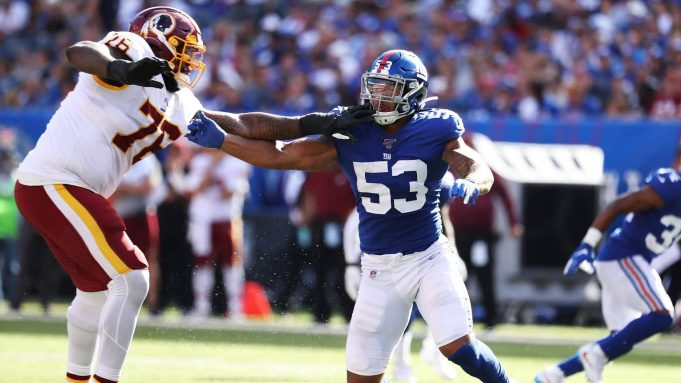 EAST RUTHERFORD, NEW JERSEY - SEPTEMBER 29: Oshane Ximines #53 of the New York Giants rushes against Morgan Moses #76 of the Washington Redskins during their game at MetLife Stadium on September 29, 2019 in East Rutherford, New Jersey.