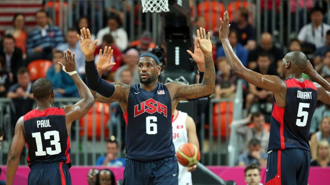 LONDON, ENGLAND - JULY 31: Lebron James #6 of United States high-fives his teammates Chris Paul #13 and Kevin Durant #5 after a play against Tunisia during the Men's Basketball Preliminary Round match on Day 4 of the London 2012 Olympic Games at Basketball Arena on July 31, 2012 in London, England.