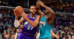MEMPHIS, TN - NOVEMBER 29: Rudy Gobert #27 of the Utah Jazz handles the ball against Jaren Jackson Jr. #13 of the Memphis Grizzlies during the first half at FedExForum on November 29, 2019 in Memphis, Tennessee. NOTE TO USER: User expressly acknowledges and agrees that, by downloading and/or using this photograph, user is consenting to the terms and conditions of the Getty Images License Agreement.