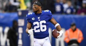EAST RUTHERFORD, NEW JERSEY - DECEMBER 29: Saquon Barkley #26 of the New York Giants warms up prior to the game against the Philadelphia Eagles at MetLife Stadium on December 29, 2019 in East Rutherford, New Jersey.