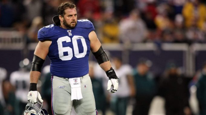 EAST RUTHERFORD, NJ - DECEMBER 13: Shaun O'Hara #60 of the New York Giants looks on against the Philadelphia Eagles at Giants Stadium on December 13, 2009 in East Rutherford, New Jersey.