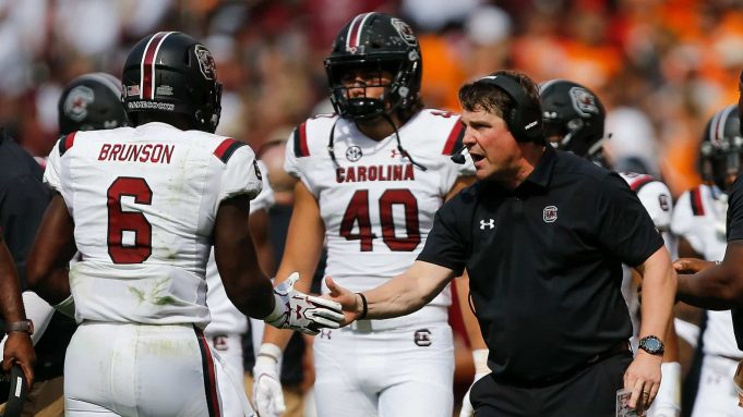 KNOXVILLE, TN - OCTOBER 14: Head coach Will Muschamp of the South Carolina Gamecocks celebrates with T.J. Brunson #6 against the Tennessee Volunteers during the first half at Neyland Stadium on October 14, 2017 in Knoxville, Tennessee.