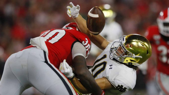 ATHENS, GEORGIA - SEPTEMBER 21: Chris Finke #10 of the Notre Dame Fighting Irish pulls in a first half catch next to Tae Crowder #30 of the Georgia Bulldogs at Sanford Stadium on September 21, 2019 in Athens, Georgia.
