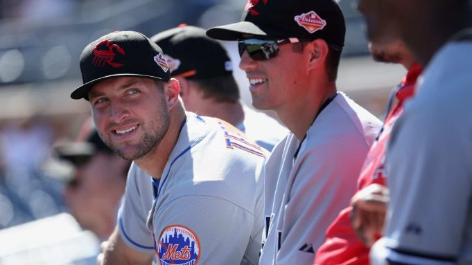 PEORIA, AZ - OCTOBER 13: Tim Tebow #15 (New York Mets) of the Scottsdale Scorpions watches from the dugout during the Arizona Fall League game against the Peoria Javelinas at Peoria Stadium on October 13, 2016 in Peoria, Arizona.