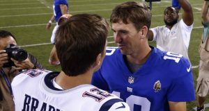 EAST RUTHERFORD, NJ - AUGUST 30: Eli Manning #10 of the New York Giants greets Tom Brady #12 of the New England Patriots after a pre-season NFL game at MetLife Stadium on August 30, 2018 in East Rutherford, New Jersey.