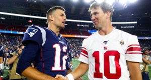 FOXBOROUGH, MA - AUGUST 29: Tom Brady #12 of the New England Patriots greets Eli Manning #10 of the New York Giants after a preseason game at Gillette Stadium on August 29, 2019 in Foxborough, Massachusetts.