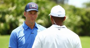 HOBE SOUND, FLORIDA - MAY 23: NFL player Tom Brady of the Tampa Bay Buccaneers talks to Tiger Woods during a practice round for The Match: Champions For Charity at Medalist Golf Club on May 23, 2020 in Hobe Sound, Florida.