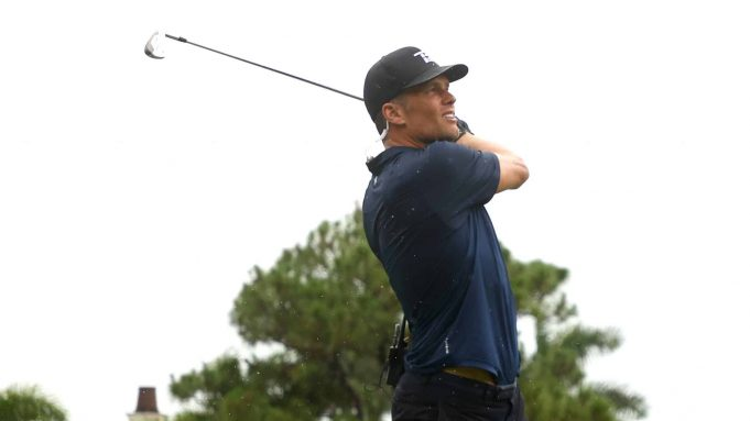 HOBE SOUND, FLORIDA - MAY 24: NFL player Tom Brady of the Tampa Bay Buccaneers plays his shot from the fourth tee during The Match: Champions For Charity at Medalist Golf Club on May 24, 2020 in Hobe Sound, Florida.