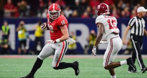 ATLANTA, GA - DECEMBER 01: Isaac Nauta #18 of the Georgia Bulldogs runs with the ball against Xavier McKinney #15 of the Alabama Crimson Tide in the first half during the 2018 SEC Championship Game at Mercedes-Benz Stadium on December 1, 2018 in Atlanta, Georgia.