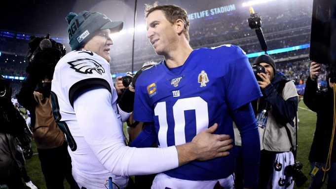 EAST RUTHERFORD, NEW JERSEY - DECEMBER 29: Josh McCown #18 of the Philadelphia Eagles greets Eli Manning #10 of the New York Giants after the second half of the game at MetLife Stadium on December 29, 2019 in East Rutherford, New Jersey.