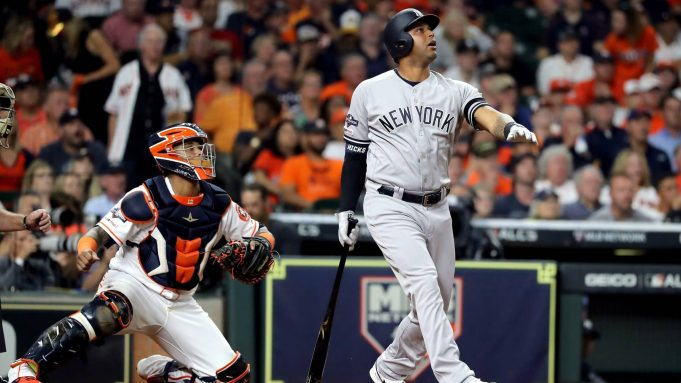 HOUSTON, TEXAS - OCTOBER 19: Aaron Hicks #31 of the New York Yankees flies out against the Houston Astros during the third inning in game six of the American League Championship Series at Minute Maid Park on October 19, 2019 in Houston, Texas.