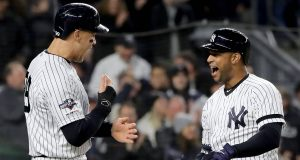 NEW YORK, NEW YORK - OCTOBER 18: Aaron Hicks #31 of the New York Yankees celebrates with Aaron Judge #99 after hitting a three run home run against Justin Verlander #35 of the Houston Astros during the first inning in game five of the American League Championship Series at Yankee Stadium on October 18, 2019 in New York City.