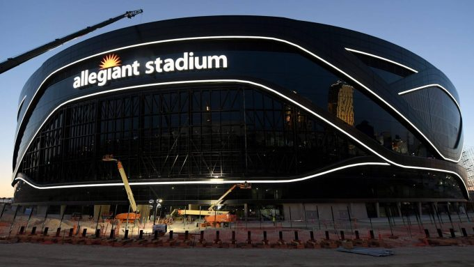 LAS VEGAS, NEVADA - APRIL 23: Crews test out architectural light ribbons and exterior sign lighting as construction continues at Allegiant Stadium, the USD 2 billion, glass-domed future home of the Las Vegas Raiders on April 23, 2020 in Las Vegas, Nevada. The Raiders and the UNLV Rebels football teams are scheduled to begin play at the 65,000-seat facility in their 2020 seasons.