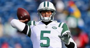 FOXBORO, MA - DECEMBER 31: Christian Hackenberg #5 of the New York Jets warms up before the game against the New England Patriots at Gillette Stadium on December 31, 2017 in Foxboro, Massachusetts.