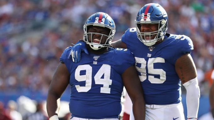 EAST RUTHERFORD, NEW JERSEY - SEPTEMBER 29: Dalvin Tomlinson #94 and B.J. Hill #95 of the New York Giants celebrates a sack of Dwayne Haskins #7 of the Washington Redskins during their game at MetLife Stadium on September 29, 2019 in East Rutherford, New Jersey.