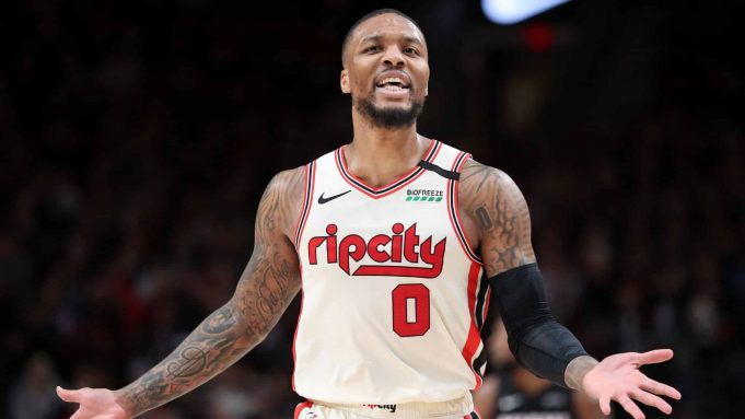 PORTLAND, OREGON - FEBRUARY 09: Damian Lillard #0 of the Portland Trail Blazers reacts to a call in the third quarter against the Miami Heat during their game at Moda Center on February 09, 2020 in Portland, Oregon. NOTE TO USER: User expressly acknowledges and agrees that, by downloading and or using this photograph, User is consenting to the terms and conditions of the Getty Images License Agreement.