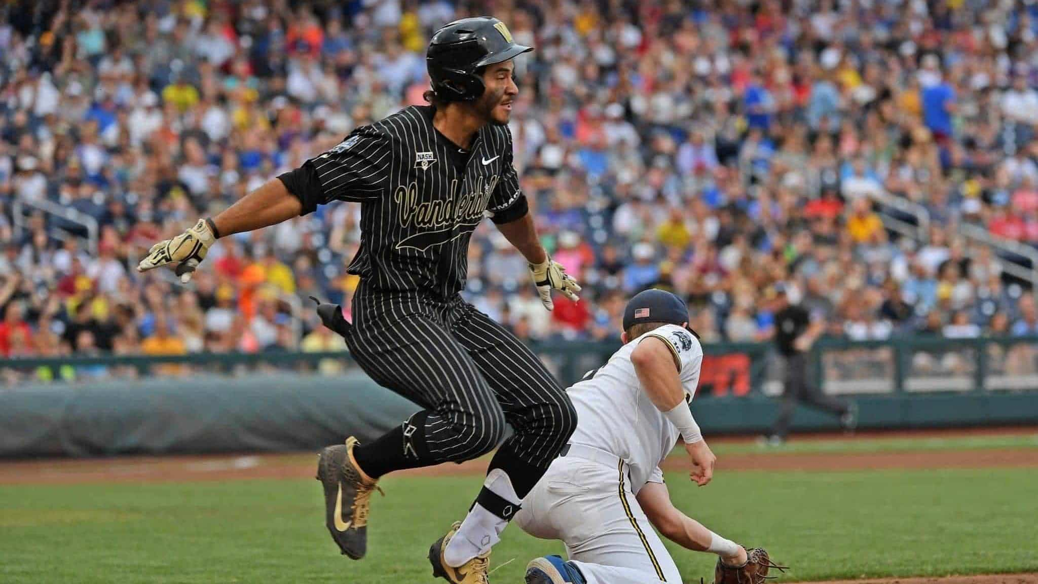 OMAHA, NE - JUNE 25: Austin Martin #16 of the Vanderbilt Commodores gets thrown out at first base in the third inning against the Michigan Wolverines during game two of the College World Series Championship Series on June 25, 2019 at TD Ameritrade Park Omaha in Omaha, Nebraska. MLB Draft