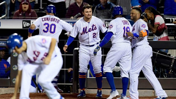 NEW YORK, NEW YORK - SEPTEMBER 24: Michael Conforto #30 and Rajai Davis #18 are congratulated by teammates Robinson Cano #24 and J.D. Davis #28 of the New York Mets after a two run home run in the ninth inning of their game against the Miami Marlins at Citi Field on September 24, 2019 in the Flushing neighborhood of the Queens borough of New York City.