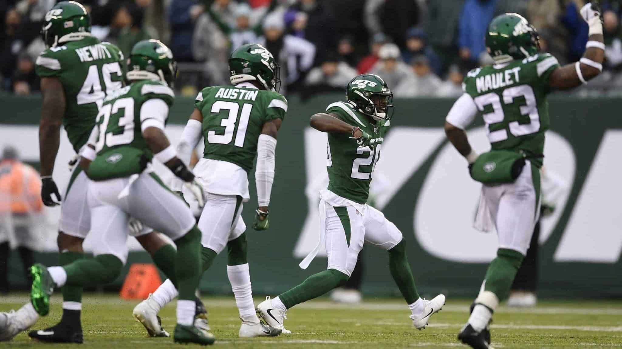 EAST RUTHERFORD, NEW JERSEY - NOVEMBER 24: Free safety Marcus Maye #20 of the New York Jets and his teammates react after stopping the Oakland Raiders one yard short of a first down during the second half of the game at MetLife Stadium on November 24, 2019 in East Rutherford, New Jersey.