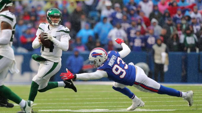 ORCHARD PARK, NY - DECEMBER 29: Sam Darnold #14 of the New York Jets looks to throw a pass as Trent Murphy #93 of the Buffalo Bills dives to try and make a tackle during the first half at New Era Field on December 29, 2019 in Orchard Park, New York.
