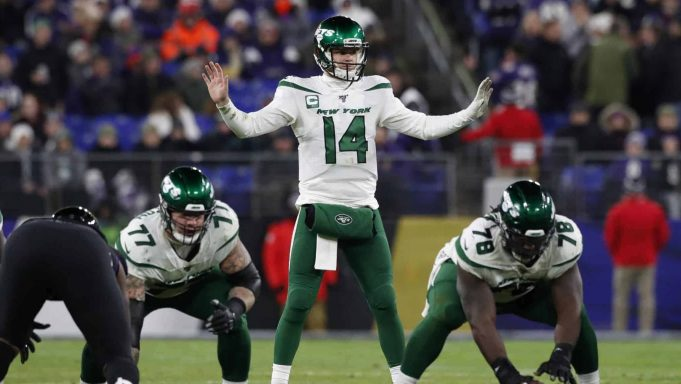 BALTIMORE, MARYLAND - DECEMBER 12: Quarterback Sam Darnold #14 of the New York Jets signals at the line of scrimmage during the second quarter against the Baltimore Ravens at M&T Bank Stadium on December 12, 2019 in Baltimore, Maryland.