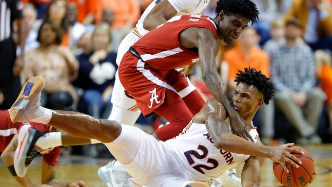 AUBURN, ALABAMA - FEBRUARY 12: Allen Flanigan #22 of the Auburn Tigers grabs a loose ball against Kira Lewis Jr. #2 of the Alabama Crimson Tide in the second half at Auburn Arena on February 12, 2020 in Auburn, Alabama.