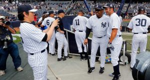 NEW YORK, NY - JUNE 22: Former New York Yankee Hideki Matsui takes a photograph of Jesse Barfield (L) and Johnny Damon prior to the teams 68th Old Timers Day before a game between the New York Yankees and the Baltimore Orioles at Yankee Stadium on June 22, 2014 in the Bronx borough of New York City.