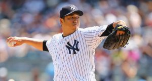 NEW YORK, NY - AUGUST 10: Hiroki Kuroda #18 of the New York Yankees pitches against the Cleveland Indians during their game at Yankee Stadium on August 10, 2014 in the Bronx borough of New York City.