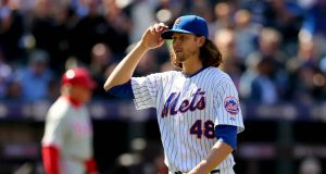 NEW YORK, NY - APRIL 13: Jacob deGrom #48 of the New York Mets salutes the fans as he is pulled from the game in the seventh inning against the Philadelphia Phillies during Opening Day on April 13, 2015 at Citi Field in the Flushing neighborhood of the Queens borough of New York City.