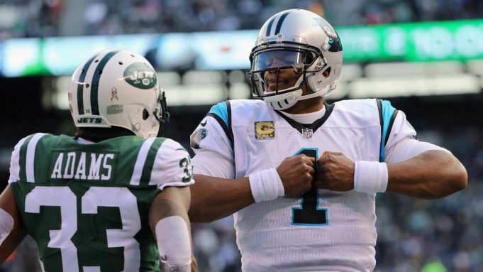 EAST RUTHERFORD, NJ - NOVEMBER 26: Quarterback Cam Newton #1 of the Carolina Panthers celebrates his touchdown against the New York Jets as strong safety Jamal Adams #33 looks on during the second quarter of the game at MetLife Stadium on November 26, 2017 in East Rutherford, New Jersey.