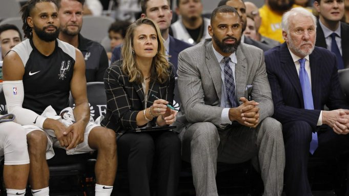 SAN ANTONIO, TX - OCTOBER 24: Patty Mills #8 of the San Antonio Spurs, assistant coaches Becky Hammon, Ime Udoka, and head coach Gregg Popovich watch action against the Indiana Pacers from the bench during an NBA game on October 24, 2018 at the AT&T Center in San Antonio, Texas. The Indiana Pacers won 116-96. NOTE TO USER: User expressly acknowledges and agrees that, by downloading and or using this photograph, User is consenting to the terms and conditions of the Getty Images License Agreement.