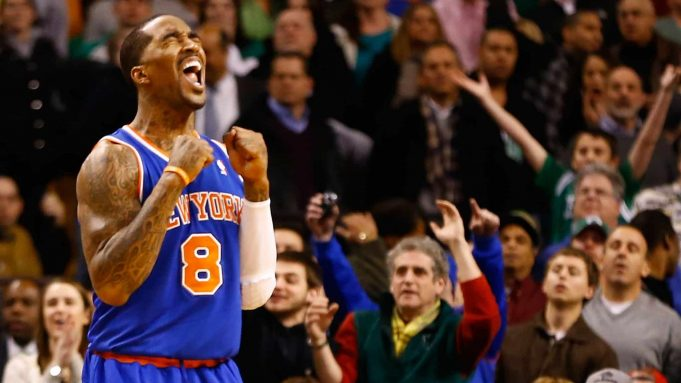 BOSTON, MA - JANUARY 24: J.R. Smith #8 of the New York Knicks reacts after Paul Pierce of the Boston Celtics lost possession of the ball in the final seconds of the fourth quarter during the game on January 24, 2013 at TD Garden in Boston, Massachusetts. NOTE TO USER: User expressly acknowledges and agrees that, by downloading and or using this photograph, User is consenting to the terms and conditions of the Getty Images License Agreement.
