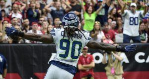 GLENDALE, ARIZONA - SEPTEMBER 29: Outside linebacker Jadeveon Clowney #90 of the Seattle Seahawks runs in an interception for a touchdown in the first half of the NFL game against the Arizona Cardinals at State Farm Stadium on September 29, 2019 in Glendale, Arizona.