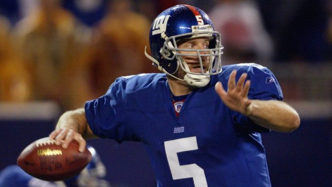 EAST RUTHERFORD, NJ - SEPTEMBER 15: Kerry Collins #5 of the New York Giants looks to pass against the Dallas Cowboys on September 15, 2003 at Giant Stadium in East Rutherford, New Jersey. The Cowboys defeated the Giants in overtime 35-32.