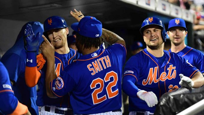 NEW YORK, NEW YORK - SEPTEMBER 27: J.D. Davis #28 and Dominic Smith #22 of the New York Mets celebrate after Davis's home run in the fourth inning of their game against the Atlanta Braves at Citi Field on September 27, 2019 in the Flushing neighborhood of the Queens borough of New York City.