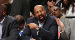 NEW YORK, NY - APRIL 15: Mike Woodson of the New York Knicks handles bench duties during the game against the Brooklyn Nets at the Barclays Center on April 15, 2014 in the Brooklyn borough of New York City. NOTE TO USER: User expressly acknowledges and agrees that, by downloading and/or using this Photograph, user is consenting to the terms and conditions of the Getty Images License Agreement.