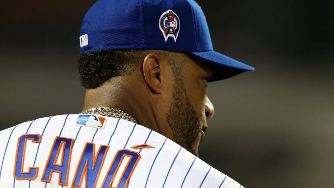 NEW YORK, NEW YORK - SEPTEMBER 11: Robinson Cano #24 of the New York Mets looks on wearing a patch on his cap in honor of the 18th anniversary of the September 11, 2001 terror attacks prior to the game against the Arizona Diamondbacks at Citi Field on September 11, 2019 in the Queens borough of New York City.