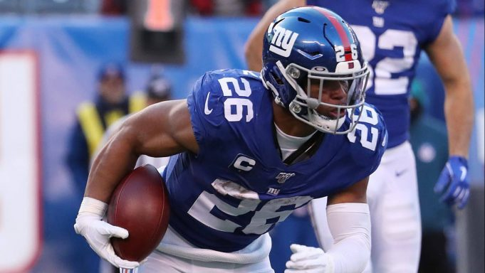 EAST RUTHERFORD, NEW JERSEY - DECEMBER 15: Saquon Barkley #26 of the New York Giants in action against the Miami Dolphins during their game at MetLife Stadium on December 15, 2019 in East Rutherford, New Jersey.