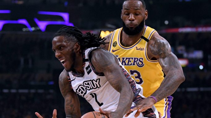 LOS ANGELES, CALIFORNIA - MARCH 10: Taurean Prince #2 of the Brooklyn Nets dribbles past LeBron James #23 of the Los Angeles Lakers during the first half at Staples Center on March 10, 2020 in Los Angeles, California.
