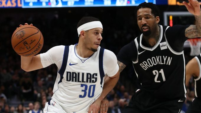 DALLAS, TEXAS - JANUARY 02: Seth Curry #30 of the Dallas Mavericks dribbles the ball against Wilson Chandler #21 of the Brooklyn Nets at American Airlines Center on January 02, 2020 in Dallas, Texas. NOTE TO USER: User expressly acknowledges and agrees that, by downloading and or using this photograph, User is consenting to the terms and conditions of the Getty Images License Agreement.