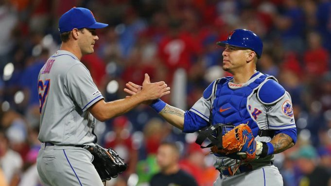 PHILADELPHIA, PA - AUGUST 31: Closer Seth Lugo #67 is congratulated by catcher Wilson Ramos #40 after defeating the Philadelphia Phillies 6-3 in a game at Citizens Bank Park on August 31, 2019 in Philadelphia, Pennsylvania.